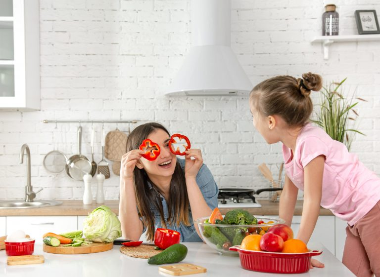 mom-and-daughter-prepare-a-salad-in-the-kitchen-have-fun-and-play-with-vegetables-the-concept-of-a-healthy-diet-and-lifestyle-vegan-nutrition-and-a-healthy-lifestyle-min